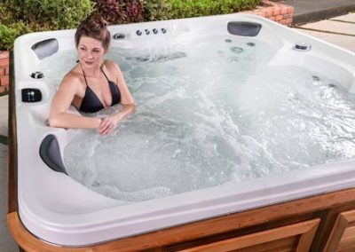 A woman relaxing in a hot tub